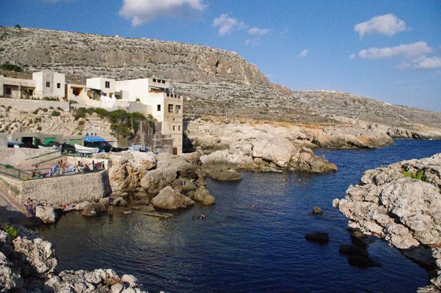 Some people swimming at Għar Lapsi