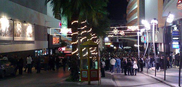 Evacuated people outside Eden Cinemas on Bay street